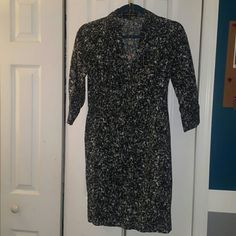 "Button up dress Black and white button up dress. I am 5'2"" and the length is a little pasted my knees.  Make me an offer :) Express Dresses Midi"