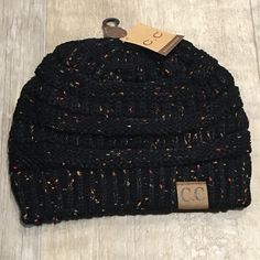 Black Confetti- Slouchy Knit Beanie Keep warm while looking ADORABLE! Super cute confetti beanie with C.C label on it. Adorable, slouchy, thick knit, and supersoft. Price is firm. Lots of colors available. Check other listings. CC Beanie. cc beanie. Not Chanel Accessories Hats