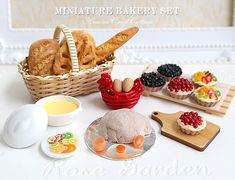 1:6 SCALE MINIATURE FAKE FOOD KITCHEN BAKING SET This is a miniature baking scene in a kitchen preparing for bakery pastries in 1:6 scale setting. Each piece handmade individually. There are 6 fruit tarts / mini pies on the wooden bakery tray. The red chicken basket is filled with