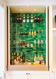 The backsplash framing the great room's wet bar is crafted from Waterworks glass tile.