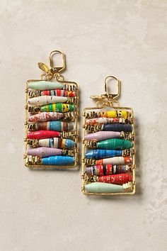 """Reading Room Earrings - Anthropologie.com - Magazine pages are sliced, rolled and perched on golden racks for your perusal. Handmade by Double Happiness in California, using rolled paper beads crafted by the women of Project Have Hope, a vocational program in Uganda.    14k gold plated metal, recycled paper, 2""""L, 1""""W, Handmade in USA"""