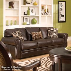 Marsala Leather Sofa 2019 Brown leather goes with almost anything including animal print! This pairing of green brown and white really gives this living room a down-to-earth feel. The post Marsala Leather Sofa 2019 appeared first on Sofa ideas. Brown Leather Sofa Living Room, Grey And Brown Living Room, Living Room Decor Brown Couch, Living Room Green, Leather Couches, Brown Sofa, Living Room Color Schemes, Living Room Colors, Living Room Paint