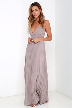 Deeper than the deep blue sea and the Grand Canyon combined ... that's how deep our love for the Depths of My Love Taupe Maxi Dress is! Elegant chiffon in a lovely taupe hue (with lavender undertones) shapes a triangle bodice and sultry V neckline supported by crisscrossing, adjustable spaghetti straps. The fitted, pintucked waistline accentuates your figure before flowing into an accordion pleated maxi skirt. Hidden back zipper and clasp. Fully lined. 100% Polyester. Dry Clean Only.