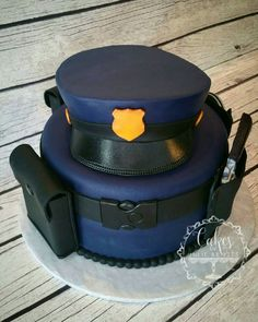 Police Officer Cake I made that sold at the Idaho Falls Policemen's Ball in October 2016! It was purchased for $550, and then redonated and resold for another $500...so a total of $1050! See more work on Facebook or Instagram at Cakes by Julie Brizzee!