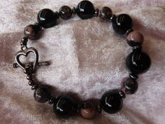 Black onyx and rhodonite beads with small by AlluringBracelets