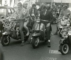 Mods on scooters in Carnaby Street during the filming of 'Steppin' Out', London, 1979. Photo by Paul Wright.