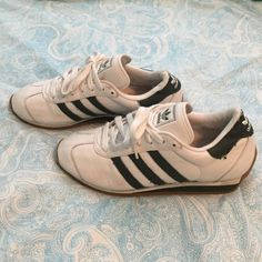 Rare! ✅ Adidas white with green stripe Size 7 ⭐️✅Super cute Adidas lace ups!! White with dark kelly green stripes. Very comfortable and slightly used. Minor scuffs that could very likely be taken out with a little shoe cleaner, and some slight fabric pilling on shoelaces. Soles of shoes are very clean!  Adidas Shoes Athletic Shoes