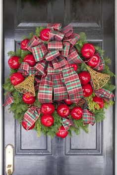 a wreath accented with bright red apples and plaid ribbon welcomes family and guests christmas - Decorated Christmas Wreaths Pinterest