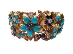 Bracelet Boucheron gold, turquoise, sapphires and diamonds. Period: 1950.
