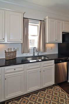 I like the curtains over the sink idea. I always get creeped out washing dishes at night!