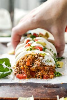 Quick, easy, comforting, inexpensive Beef and Bean Burritos stuffed with the BEST FILLING you will be eating with a spoon is the answer to your weekday dinner woes!