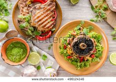 Grilled Pork Chops and risotto with portobello, rustic styled photo