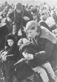 Babi Yar - 1-Close-up of a young mother with her two children who have been assembled for mass execution by the Germans.