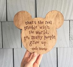 "Handmade wood burned Mickey ears. Comes with sawtooth hanger on the back for walls. YOU choose the Walt Disney quote to be burned!About 8"" by 9"". *Currently, orders take about 10-16 business days to be made, depending on the product. Once made, they are shipped off. *"