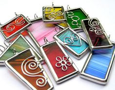 Stained glass pendants - I bet this would be a pretty design for shrinky dinks!