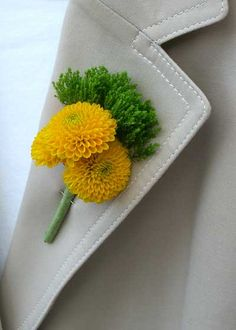 Men's Boutonniere from flowerduet.com made with yellow button mums and green Trick Dianthus. #FinishWithFlowers