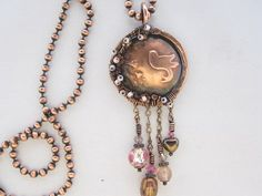 Wire wrapped copper necklace with bird and cherry blossoms