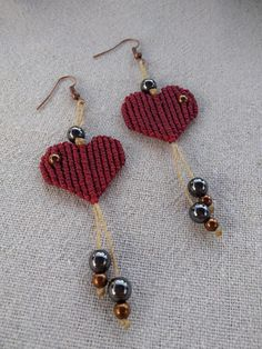 Macrame heart earrings Materials used: Hematite beads High quality waxed linhasita cord Meatalic earring hooks Glass beads Length: 9cm Width: 2,5cm If you have any questions about this product, Ill be happy to answer them. Made by CraftyMargie with good vibes and love :) Connect