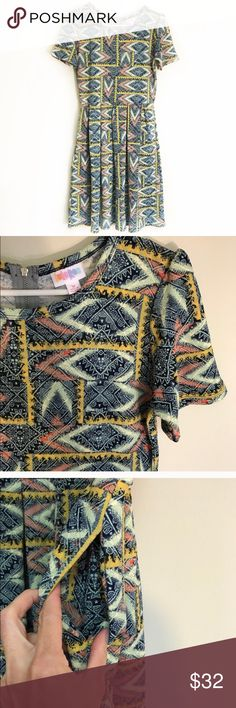 LULAROE Aztec print Amelia dress size medium EUC LULAROE Amelia dress size medium. Zip closure in back and pockets! Excellent condition, like brand new! LuLaRoe Dresses