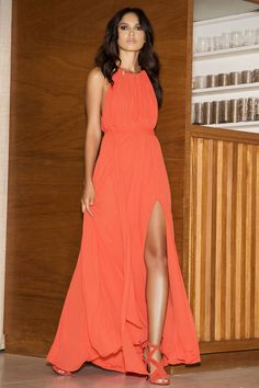 Gleam and Glide Orange Maxi Dress! Lovely woven poly swings from a drawstring halter neckline (with gold accents), into a cutout bodice with plunging V-neck. Elasticized waist with tying sash belt tops the maxi skirt with side slit. Low V-back.