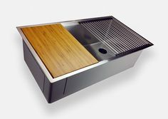 Ledge Sinks allow a cutting board to glide the length of the sink. Other accessories include stainless steel roll mats and colanders.