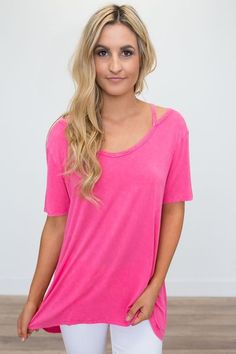 Shop our Cold Shoulder Short Sleeve Tunic in Hot Pink. Free shipping on all US orders!