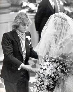 Iconic weddings: Prince Charles and Lady Diana Spencer It was created for her by Elizabeth and David Emanuel, pictured with the Princess ahead of the ceremony.