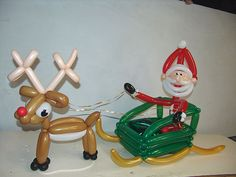 Need some christmas balloon decorations for your company party? These twisted balloon sculptures add huge holiday fun. Balloon Centerpieces, Balloon Decorations, Christmas Decorations, Christmas Balloons, Christmas Art, Santa Sleigh, Santa And Reindeer, Balloon Pictures, Balloon Modelling