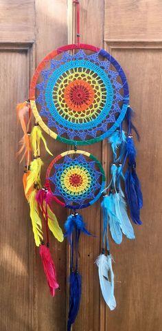 Double rainbow dreamcatcher with rainbow feathers handmade in Bali, Indonesia.