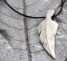 Carved elk antler feather pendant by SassySudburySisters on Etsy