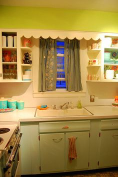 Colorful and vintage kitchen-- love that wall color!