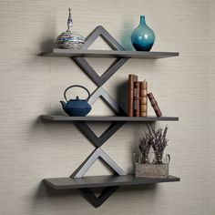 @Overstock - Diamonds Three Level Shelving System - This modern wall shelf unit in gunpowder grey will add storage space to your walls while creating a distinctive designer look. Its decorative diamond shaped brackets hold three shelves that can be presented together as a unit, or as three separate units.  http://www.overstock.com/Home-Garden/Diamonds-Three-Level-Shelving-System/9237689/product.html?CID=214117 $67.99