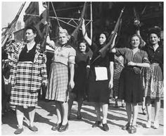Female members of the French Resistance celebrate the liberation of Marseille by French and US forces, August 1944.