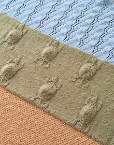 Knitting Pattern for Turtle's Journey Blanket - This baby blanket by Heather Anderson features 3 sections to represent baby sea turtles making their way from sand to sea – a textured stitch for the beach, the section for the baby turtles, and a wavy lace pattern for the ocean. Pictured project by gatonero: