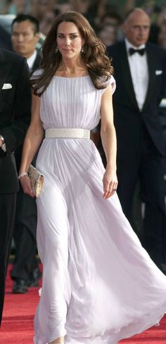 Kate Middleton has really settled into her role as a glamorous fashion icon. For the BAFTA Awards in Los Angeles in July, she opted for this violet pleated dress with a simple white glitter belt designed by Alexander McQueen.