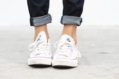 Jeans, white sneakers.