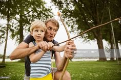 View top-quality stock photos of Father And Son Playing With Self Made Bow And Arrow. Find premium, high-resolution stock photography at Getty Images. Business Flyer Templates, Father And Son, How To Make Bows, Creative Business, Sons, Stock Photos, Arrow, Photography, Fit