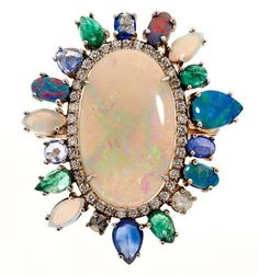 NinaRunsdorf ~ White Gold Opal ring with sapphires, emeralds and white diamonds