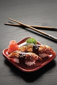 Unagi: Cooked Saltwater Eel, filet. Nigiri style, with the sweet, tangy sauce that always accompanies it. Great for first-timers who are squeamish about eating anything raw, and loved by connoisseurs.