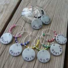 hese wine charms are made from polymer clay (not metal). They are then hand stamped, baked and painted with a coat of finishing glaze. They last longer if not washed in a dishwasher. Wipe with a damp cloth if necessary to clean.