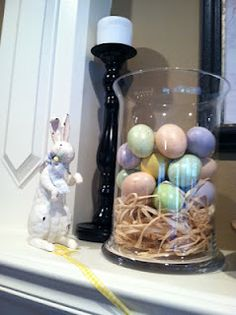 Eggs and twine in a vase