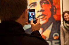 A man takes a picture of his wife standing next to Shepard Fairey's portrait of US President Barack Obama, based on a photograph by Mannie Garcia, at the National Portrait Gallery in Washington on January 19, 2013, two days before Obama's second inauguration. AFP PHOTO/Nicholas KAMM = MANDATORY MENTION OF THE ARTIST UPON PUBLICATION = (Photo credit should read NICHOLAS KAMM/AFP/Getty Images) Presidential Inauguration, National Portrait Gallery, Us Presidents, Barack Obama, Photo Credit, Washington, January, Take That, Photograph