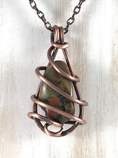 I handcrafted this copper jewelry piece with 12 gauge solid copper wire wrapped around a Fancy Jasper stone. When worn as a decorative necklace Jasper is said to combat exhaustion. Jasper symbolizes will power, known as the warriors stone Copper Wire Jewelry, Wire Jewelry Designs, Wire Wrapped Jewelry, Stone Jewelry, Leather Jewelry, Jewelry Accessories, Jewelry Logo, Beaded Jewelry, Stone Wrapping