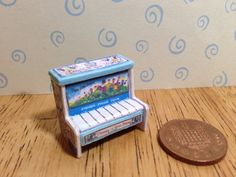 A personal favourite from my Etsy shop https://www.etsy.com/uk/listing/230580328/hand-made-dolls-house-miniature-replica