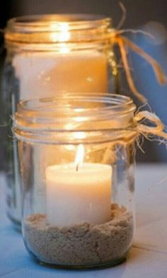 Beach sand inside mason jars and tea lights w/twine.