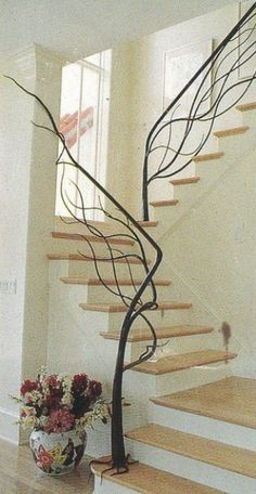 Stair banister railing that looks like a tree. Too cool!