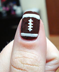 Football nails. Might do this for an accent nail during football season!