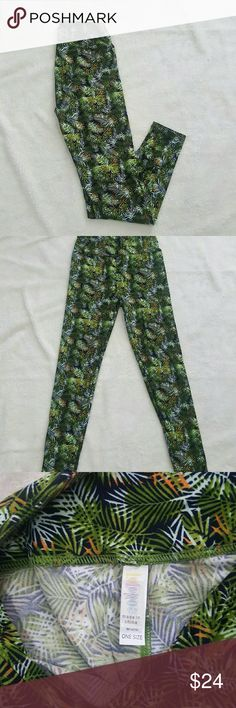 [LuLaRoe] Palm Tree Printed OS Leggings In good used condition. Little to no wear showing on these OS size leggings.? So no piling, no thinning of the material, nothing like that! Mix of green & brown palm tree leaves and a little bit of pink/coral? accents on a dark gray/black background.   Offers are always welcome! Thanks for looking! Bundle 2 or more and save 20%! LuLaRoe Pants Leggings