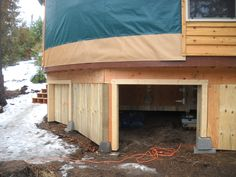 Great use of yurt under deck space. Elevated storage compartments. http://www.shelterdesigns.net/