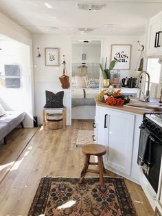 Dwell - A Couple Spend $3K to Turn an Old RV Into a Cozy Home For Five